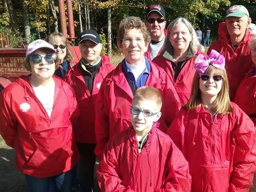 Rev. Marguerite Sheehan is surrounded by some Sunday friends and other church friends at the CROP Hunger Walk.