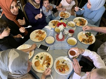community meal includes Muslim families